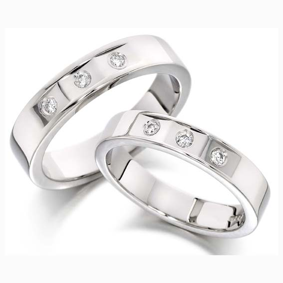 226 - Three flattened grooves set with round diamonds.