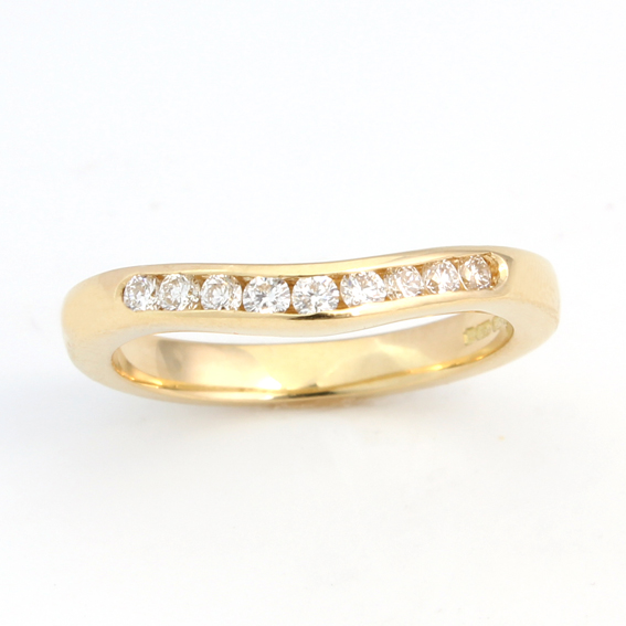 607 - Narrow curve with nine channel set round diamonds.