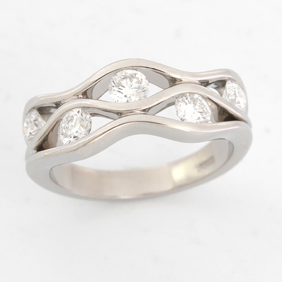 Diamond set wave ring