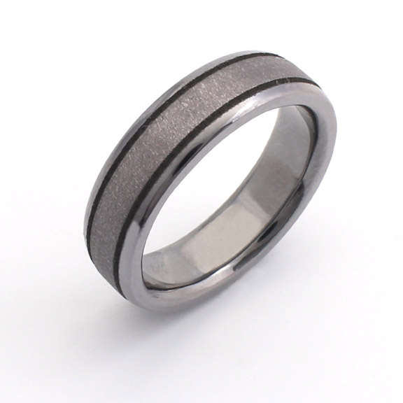 Tantalum ring with polished stepped edges and brushed centre